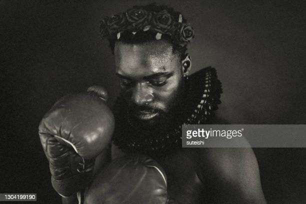 the fighter with the rosary - arte, cultura e espetáculo imagens e fotografias de stock