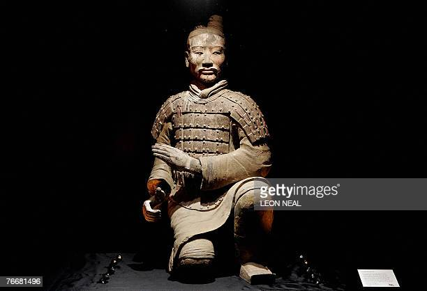 The figure of a kneeling archer is displayed at an exhibition entitled 'The First Emperor China's Terracotta Army' at the British Museum in central...