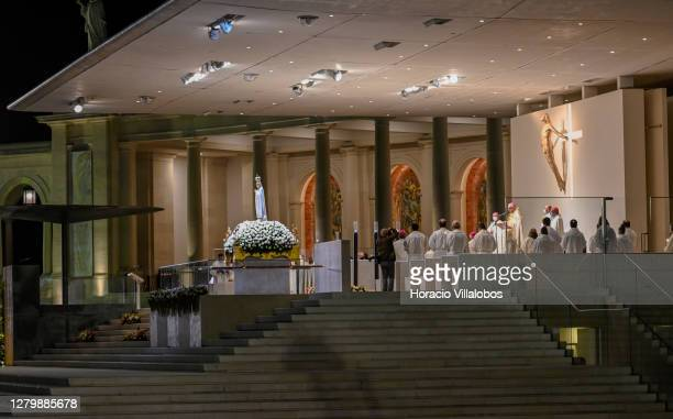 The figure of Our Lady of Fátima during the evening procession of candles at the sanctuary on the first day of the ceremonies in which Catholics...