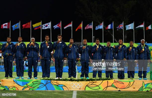The Fiji players pose with their gold medals following victory during the Men's Rugby Sevens Gold Medal match between Fiji and Great Britain on day...