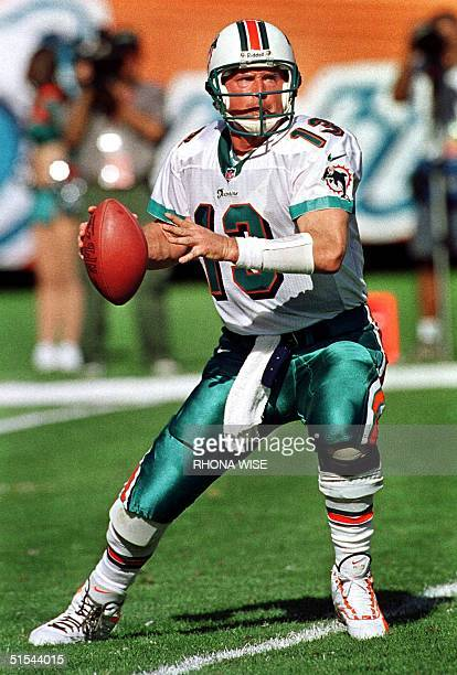 The file photo shows Miami Dolphins quarterback Dan Marino as he drops back to pass against the San Diego Chargers 19 December 1999 at Pro Player...