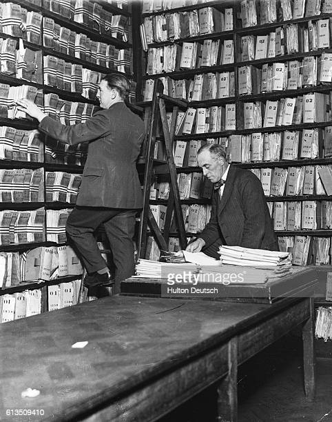 The file shelves in the Criminal Record Room at London's Metropolitan Police headquarters Scotland Yard