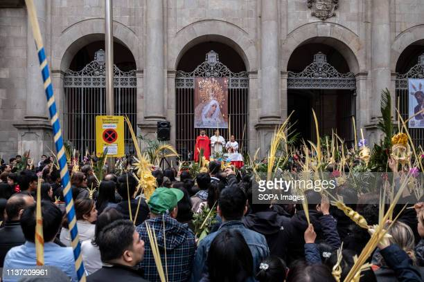 The Filipino community of Barcelona is seen during the procession. Christianity celebrates the entrance of Jesus Christ into Jerusalem with the...
