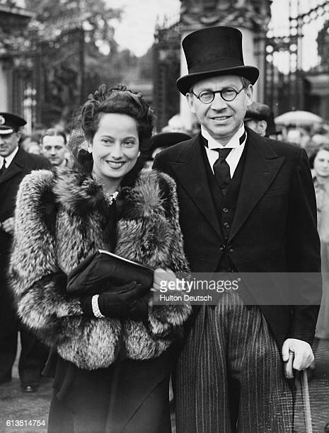 The film director Alexander Korda with his wife the film star Merle Oberon leave Buckingham Palace following his knighthood 1942
