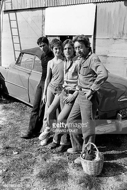 The film unit of the movie 'Je t'aime moi non plus' is pictured on October 5 1975 in front of a car on the set of the movie in Belvezet near Uzes...