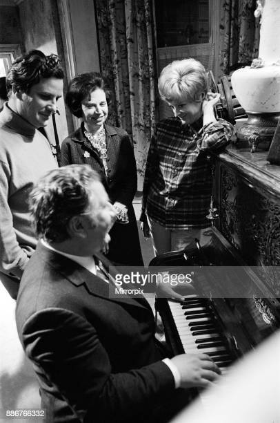 The filming of MGM's comedy 'Hot Millions' Pictured seated at the piano is Peter Ustinov who plays con artist Marcus Pendleton standing on the right...