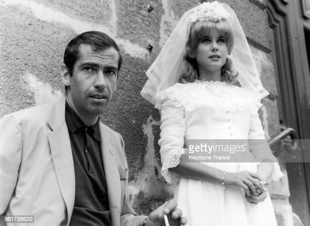 The filmmaker Roger VADIM and the actress Catherine DENEUVE his partner shooting the wedding scene of the film LE VICE ET LA VERTU in 1962