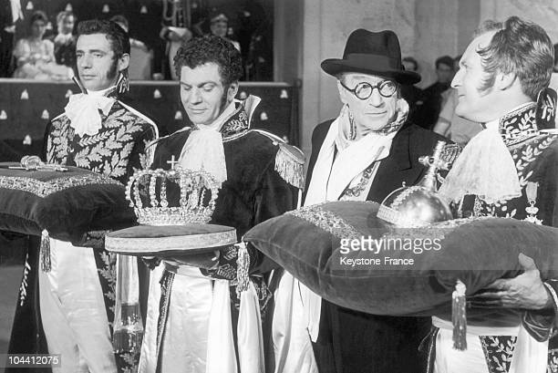 The filmmaker Sacha GUITRY directing the actors in the film NAPOLEON The film was shot in the chapel of the VERSAILLES castle the scene representing...