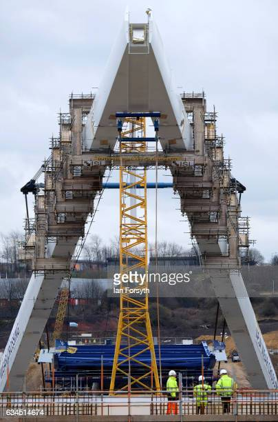 The final 100 metre centrepiece of Sunderland's new River Wear crossing is lifted into place on February 10 2017 in Sunderland United Kingdom The...