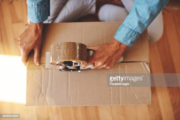 the final box - tape dispenser stock photos and pictures