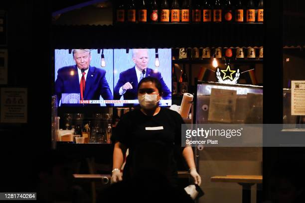 The final debate between President Donald Trump and Joe Biden plays on a restaurant television in Manhattan on October 22, 2020 in New York City. The...