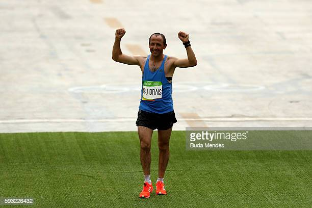 The final finisher Methkal Abu Drais of Jordan crosses the finish line during the Men's Marathon on Day 16 of the Rio 2016 Olympic Games at...