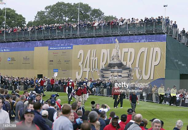 The final Fourball group walk down the first fairway during the morning fourball matches on the first day of the 34th Ryder Cup at the De Vere Belfry...