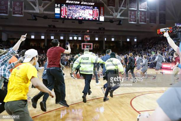 The final horn blows and the court is rushed during a game between the Boston College Eagles and the Duke University Blue Devils on December 9 at...