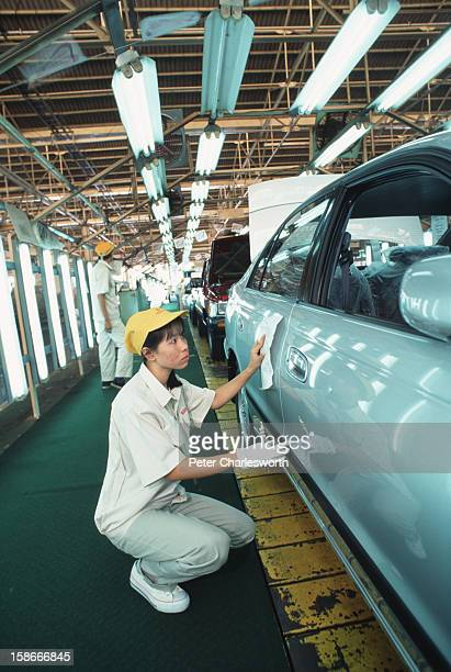 The final inspection of cars rolling off a Toyota production line at the Toyota factory on the outskirts of Bangkok