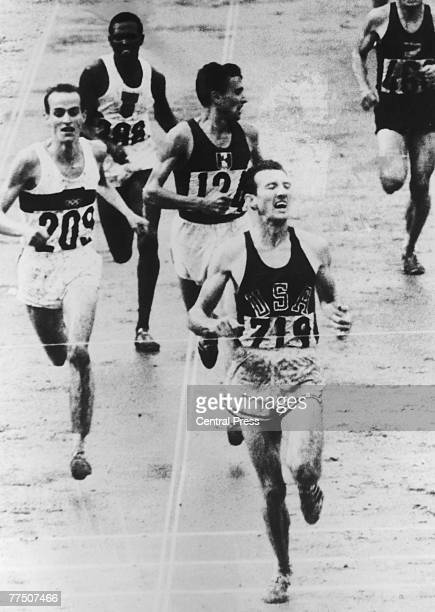 The final of the Men's 5000 Metres at the Tokyo Olympics 1st October 1964 American athlete Bob Schul wins the gold medal and West Germany's Harald...