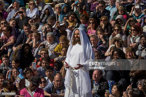 The final scene of a risen Jesus as he passes among the audience after being crucified on the cross during The Passion of Jesus which is performed in...