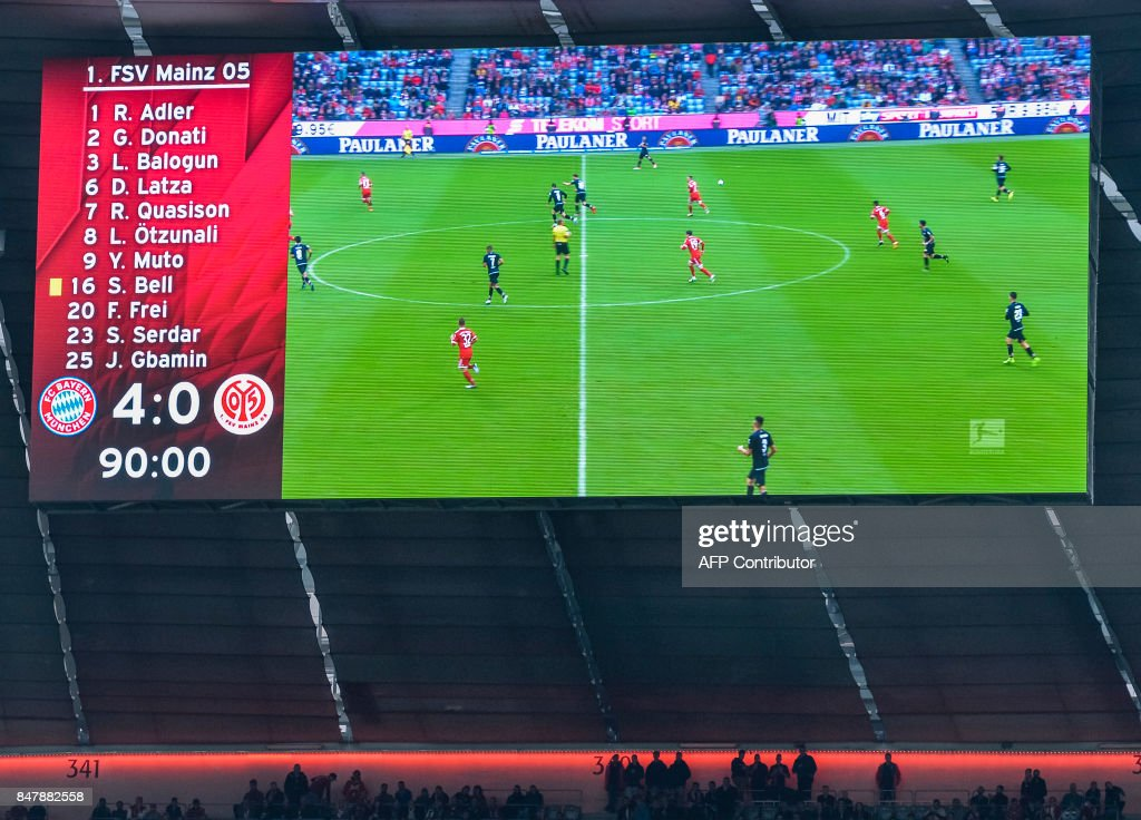 The final score 4-0 can be seen on the board during the German First division Bundesliga football match FC Bayern Munich v Mainz 05 in Munich, southern Germany, on September 16, 2017. / AFP PHOTO / Guenter