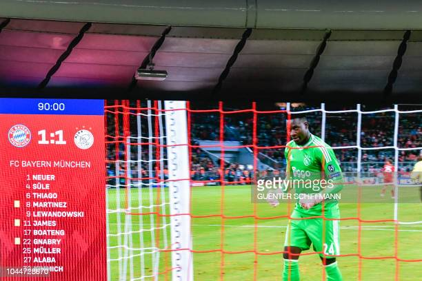 The final score board with Ajax's Cameroonian goalkeeper Andre Onana on it is seen after the UEFA Champions League Group E football match between...
