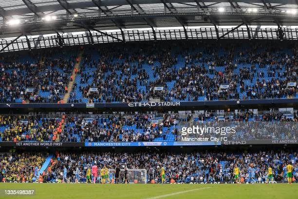 The final score is seen as players leave the field during the Premier League match between Manchester City and Norwich City at Etihad Stadium on...