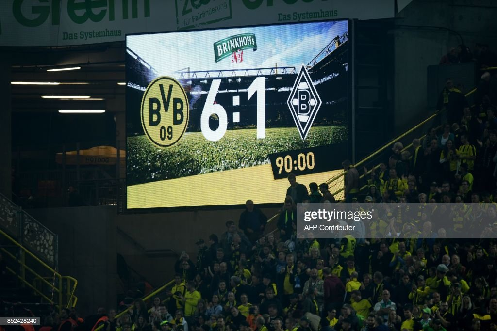 The final score is seen on the stadium display after the German First division Bundesliga football match Borussia Dortmund vs Borussia Moenchengladbach in Dortmund, western Germany, on September 23, 2017. /