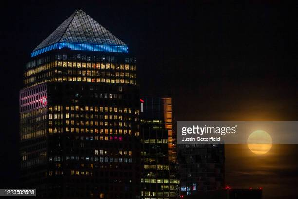 The final super moon of the year, also known as the flower moon, rises over Canary Wharf on May 07, 2020 in London, United Kingdom. A supermoon...