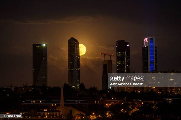 The final super moon of the year also known as the flower moon rises over Cuatro Torres Business Area on May 07 2020 in Madrid Spain A super moon...