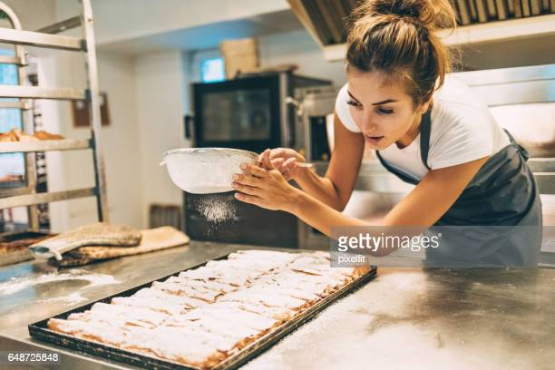 the final touch for the perfect pasrty - bakery stock pictures, royalty-free photos & images
