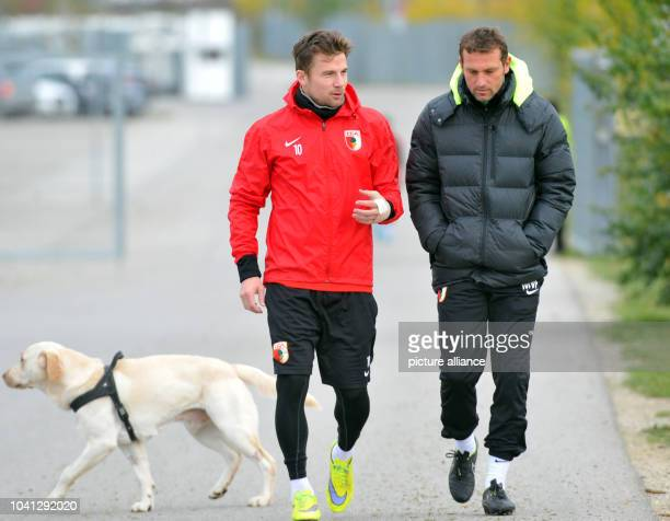 The final training session before FC Augsburg before the Europa League game against AZ Alkmaar in Augsburg Germany 4 October 2015 Daniel Baier speaks...