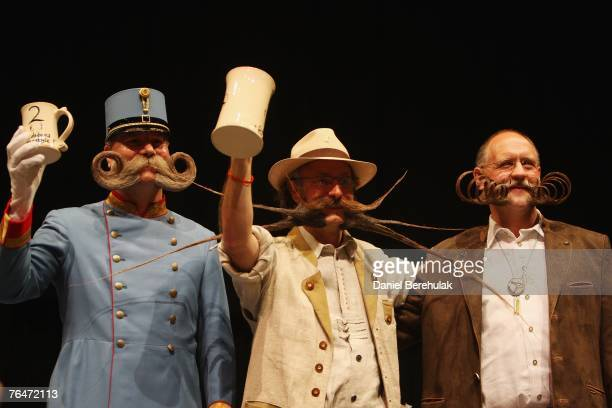 The finalists of the Sideburns Freestyle Category hold their prize mugs during the World and Moustache Championships at the Brighton Centre on...