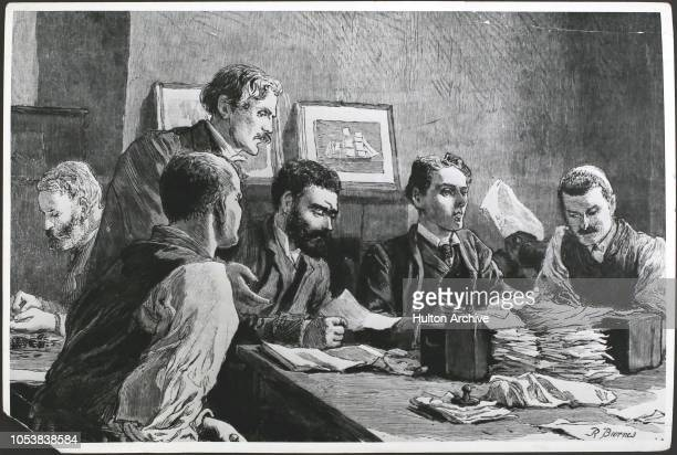 The Finance Committee issuing relief tickets at the Wade Arms Jeremiah Street Poplar the Strikers' headquarters during the great strike of dock...