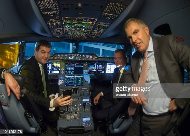 The Finance Minister of Bavaria Markus Soeder the Lord Mayor of Nuremberg Ulrich Maly and Lufthansa CEO Carsten Spohr inspect the new Lufthansa...