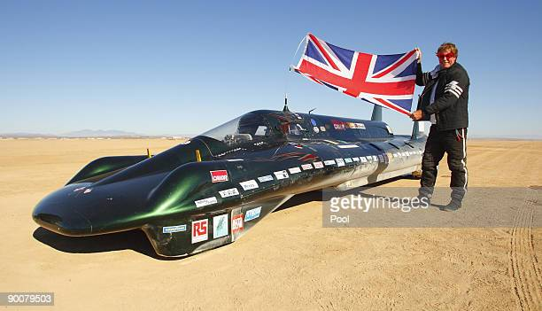 The financial backer and driver of The British Steam Car Challenge team Charles Burnett III celebrates beside his vehicle at Rogers Dry Lake on...