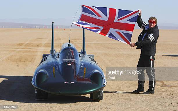 The financial backer and driver of The British Steam Car Challenge team Charles Burnett III celebrates beside his vehicle after breaking the land...