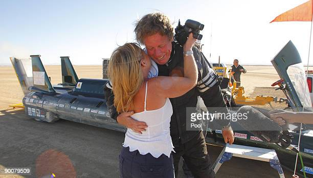 The financial backer and driver of The British Steam Car Challenge team Charles Burnett III celebrates beside his vehicle with Pam Swanston at Rogers...
