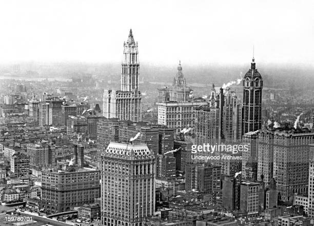 The Financial District in New York City with the Singer Building and its rounded top at the right and the Woolworth Building in the center New York...