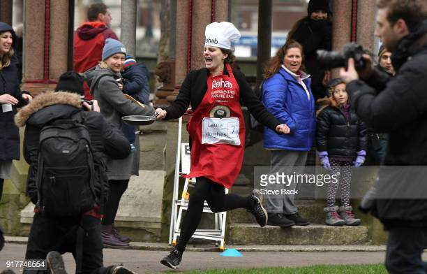 The Financial Times reporter Laua Hughes approachess the first corner in the annual Parliamentary Pancake Race in Victoria Tower Gardens on Shrove...