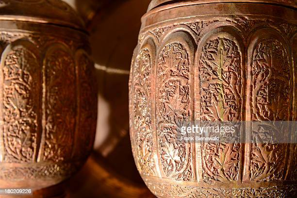 SRINAGAR JAMMU KASHMIR INDIA The fine art work of a Samovar handmade by a coppersmith in his shop in the old city