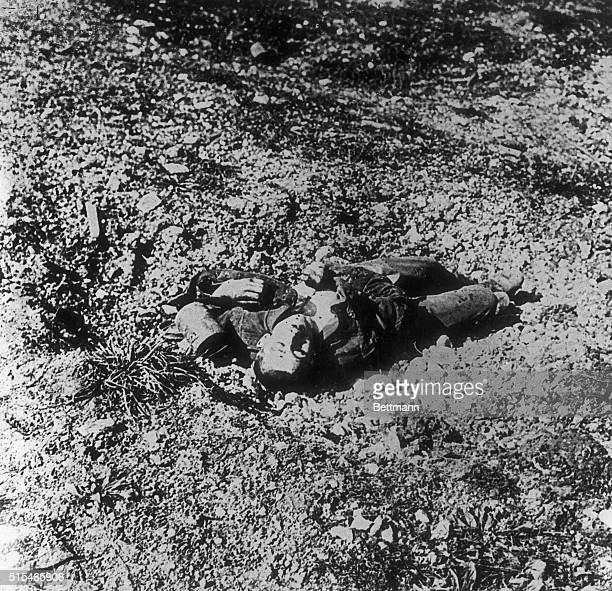 The fine looking German lad lay on the bullet riddled battlefield of Louvain, the Belgian University city which felt so heavily the weight of the...