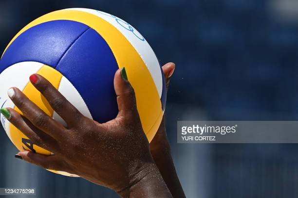 The fingernails of Kenya's Gaudencia Makokha are painted in the colours of the Kenya national flag as she prepares to serve the ball in their women's...