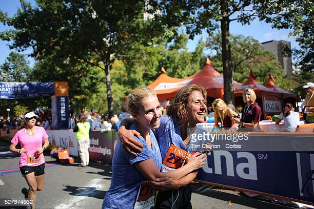 The Finish Line Expressions of agony and ecstasy on the faces of athletes as mum and daughter Janet Bunke and Melanie Bunke finish the ING Hartford...