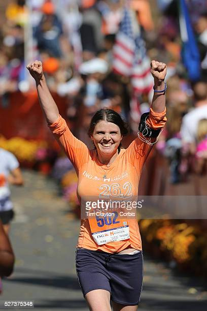 The Finish Line Expressions of agony and ecstasy on the faces of athletes as Rebekah Webb New York finishes the ING Hartford Marathon Bushnell Park...