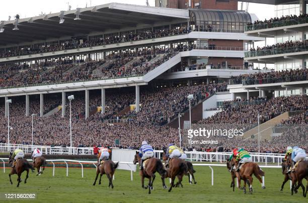 The finish of the first race in front of packed stands during day four of the Cheltenham National Hunt Racing Festival at Cheltenham Racecourse on...