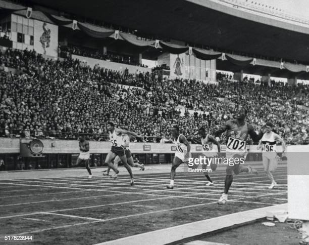 The finish of the Olympic 10 meter final here October 15th shows America's Bob Hayes breaking the tape to tie the world record Hayes ran the fastest...