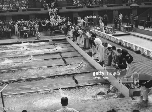 The finish of the second heat of the Men's 100-Metres Freestyle event at the Empire Pool, Wembley during the London Olympics, 30th July 1948. The...