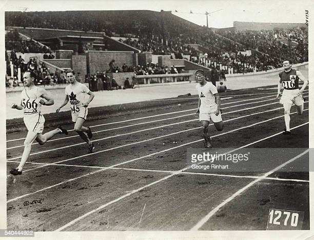The finish of the sixth heat of the 200meter dash The winner of this heat is Jackson Scholz of the US second came Adams of Canada Note the desperate...