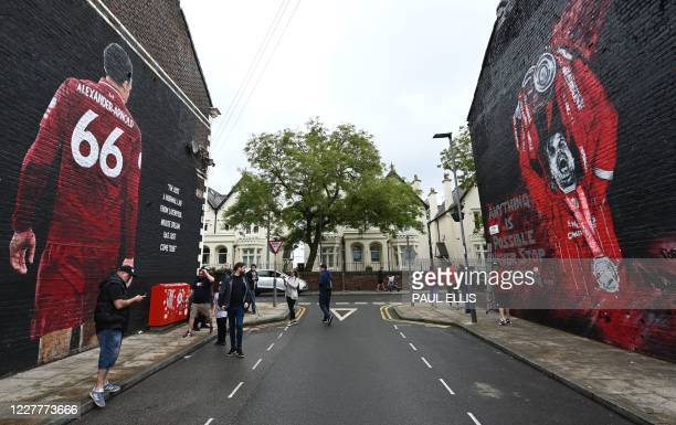The finished new mural of Liverpool's English midfielder Jordan Henderson lifting the Premier League trophy created by graffiti artists MurWalls in...