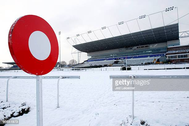 The finishing post stands surrounded by snow as winter race meetings at the Kempton Park race course are cancelled due to the snowy conditions on...