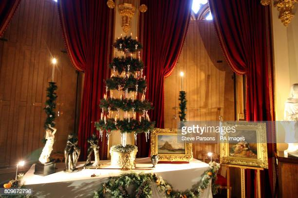 The finishing touches to a Christmas tree which at Windsor Castle. The tree is part recreation of Queen Victoria's Christmas at the Castle.