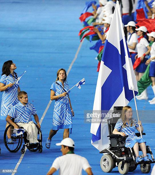 The Finland delegation parades during the 2008 Beijing Paralympic Games opening ceremony at the National Stadium better known as the Bird's Nest in...